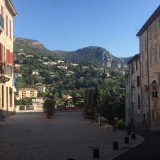 A square in Vence with a view on the mountains above the town