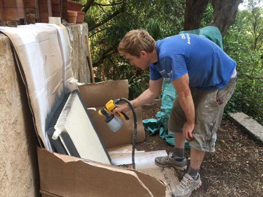 Andy spraying old radiators grey