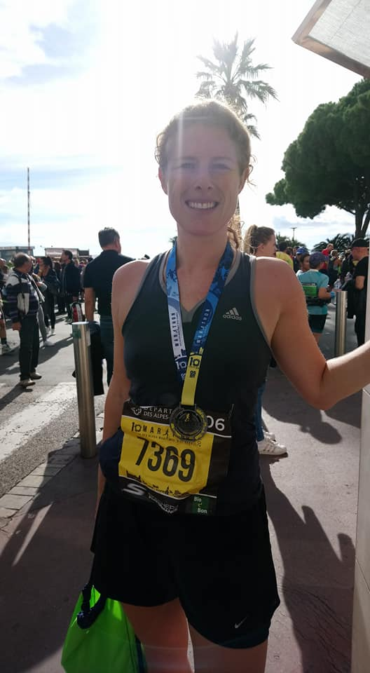 Lorna with race number and medal on Cannes Croisette