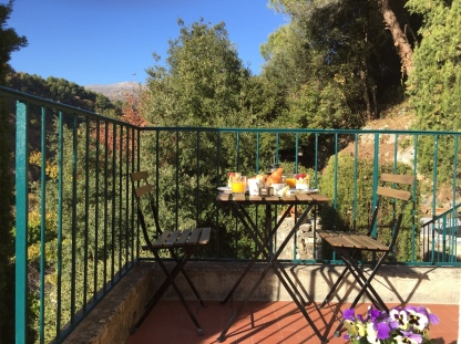 A table laid for breakfast on the terrace at Villa Rocamar