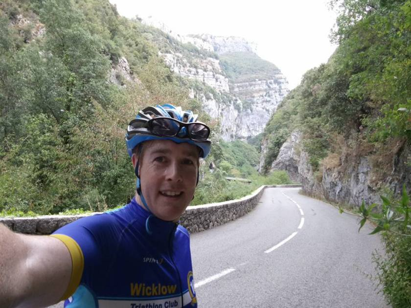 Cyclist selfie on road that goes through the gorge