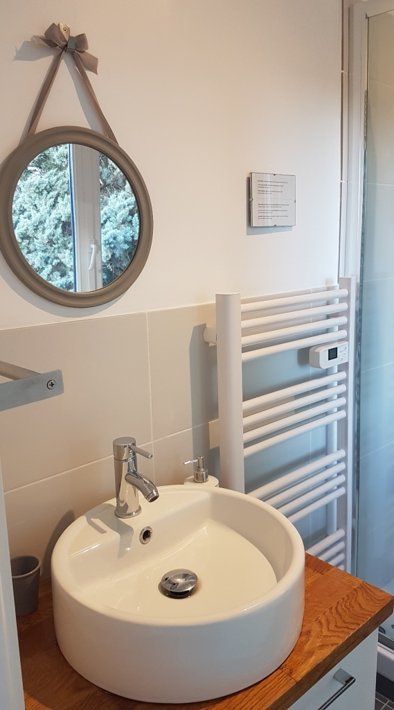 Sink, mirror and towel rail in bathroom of St Jeannet bedroom